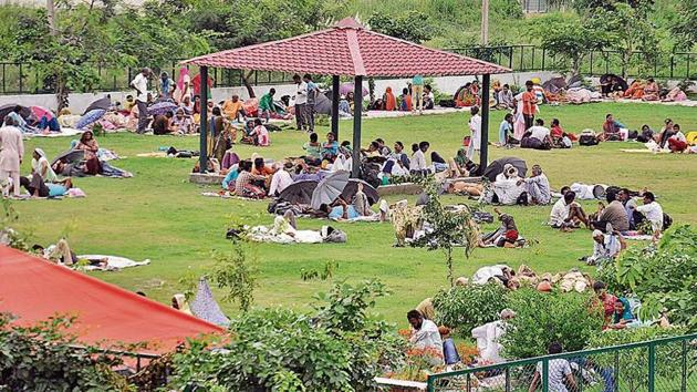Dera Sacha Sauda followers resting at a park in the sect's Naam Charcha Ghar in Sector 23, Panchkula, on Tuesday. They have reached here from different parts of the region.(Sant Arora/HT)