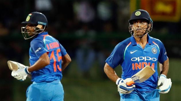 MS Dhoni and Bhuvneshwar Kumar run between wickets during the second ODI against Sri Lanka. Get full cricket score of India vs Sri Lanka here.(REUTERS)