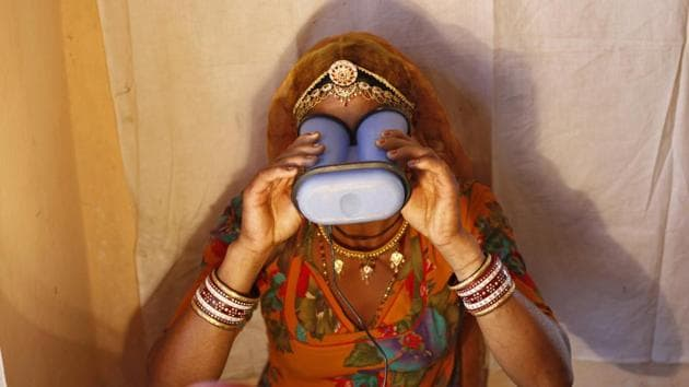 A woman goes through the process of eye scanning for Unique Identification (UID) database system at an enrolment centre at Merta district in Rajasthan February 21, 2013.(REUTERS)