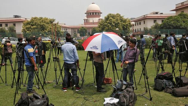 Television journalists parked outside the premises of the Supreme Court in New Delhi, on August 22, 2017. The court made a watershed ruling on Thursday when it upheld right to privacy as a fundamental right.(Reuters Photo)