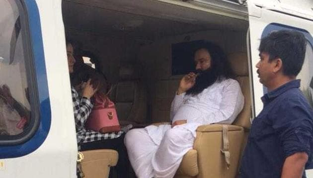 Gurmeet Ram Rahim Singh being taken in a chopper to Rohtak. The CBI court will announce the quantum of punishment for Singh on August 28. He faces up to seven years' in jail.(HT Photo)