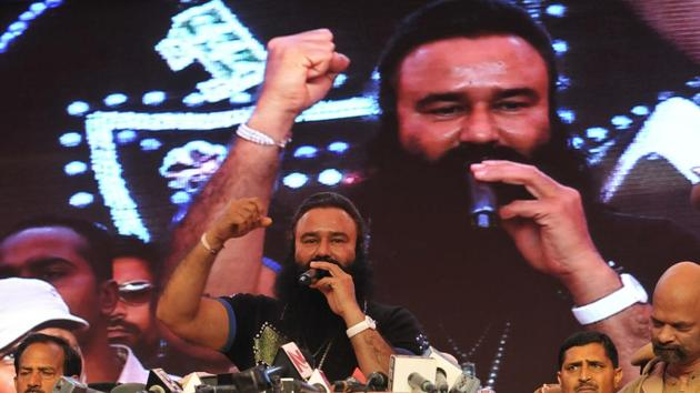 A file photo of Dera chief Ram Rahim at a movie promotion.(Sunil Saxena/ Hindustan Times)