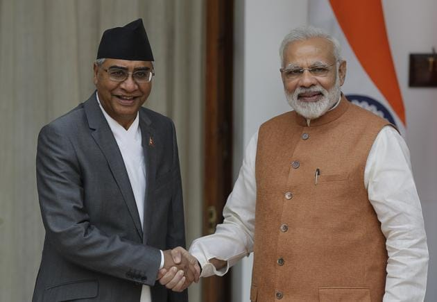 Indian Prime Minister Narendra Modi (right) with his Nepalese counterpart Sher Bahadur Deuba in New Delhi, India, August 24(AP)