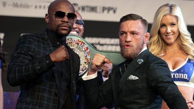 Boxer Floyd Mayweather Jr. (L) and MMA figher Connor McGregor pose during a media press conference August 23, 2017 at the MGM Grand in Las Vegas, Nevada. Mayweather, the 40-year-old undefeated former welterweight boxing champion, has been lured out of retirement to face McGregor, a star of mixed martial arts' Ultimate Fighting Championship. The two men meet in a 12-round contest under boxing rules on August 26th that is tipped to become the richest fight in history. Live streaming of the Mayweather vs McGregor fight was available online on Sunday morning at 9 AM in India.(AFP)