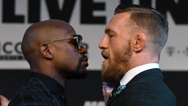 Floyd Mayweather (L), who has an unbeaten record of 49-0 in professional boxing, will take on Conor McGregor -- the UFC lightweight champion -- in Las Vegas on August 26.(AFP)