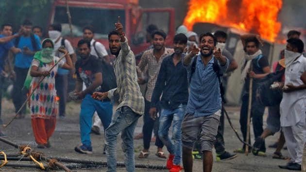 Supporters of Gurmeet Ram Rahim's Dera Sacha Sauda react during the violence in Panchkula, on August 25, 2017.(Reuters Photo)