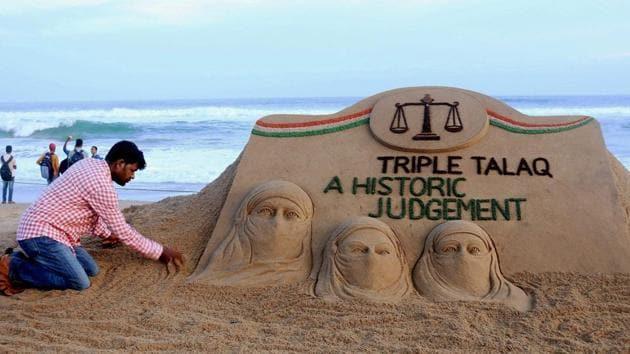 "Sand artist Sudarsan Pattnaik creates a sand sculpture with the message ""Triple Talaq A Historic Judgement"" at Puri beach of Odisha.(PTI)"