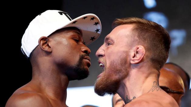 Undefeated boxer Floyd Mayweather Jr. (L) of the U.S. and UFC lightweight champion Conor McGregor of Ireland face off during their official weigh-in at T-Mobile Arena in Las Vegas, Nevada, on Friday.(REUTERS)