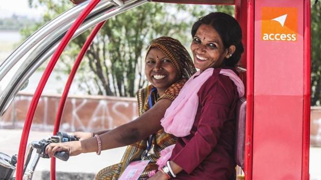 A not-for-profit organisation has trained women from the weaker sections of the society to drive the battery-operated e-rickshaws that have been modified and painted pink.(HT Photo)