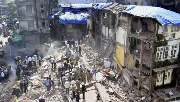 Rescue work in progress after a five storey building collapsed in Bhendi bazaar in Mumbai on Thursday.(PTI Photo)
