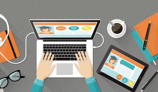 E-learning, education and university banner, student's desktop with laptop, books and hands, top view(Istock)