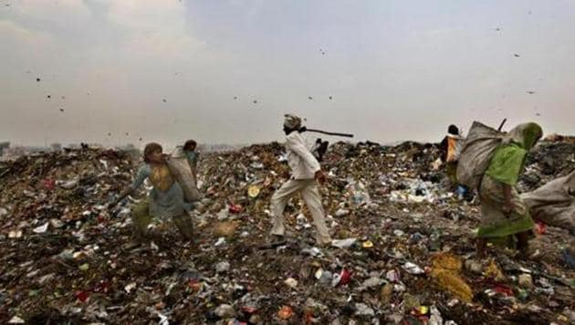 East Delhi Municipal Corporation officials say danger is not over yet as more parts of Ghazipur landfill site can cave in too.(Raj K Raj/HT Photo)