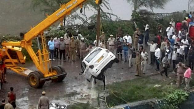 Rescue and relief operations underway after a part of the Ghazipur garbage landfill collapsed in east Delhi on Friday afternoon. Several people and a vehicle were swept into the canal after the mishap.(PTI Photo)
