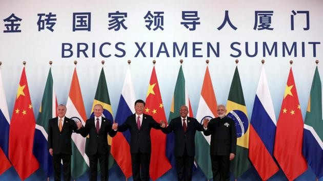 From left, Brazil's President Michel Temer, Russian President Vladimir Putin, Chinese President Xi Jinping, South Africa's President Jacob Zuma and Indian Prime Minister Narendra Modi pose for a group photo during the BRICS Summit at the Xiamen International Conference and Exhibition Center in Xiamen, southeastern China's Fujian Province.(AP Photo)
