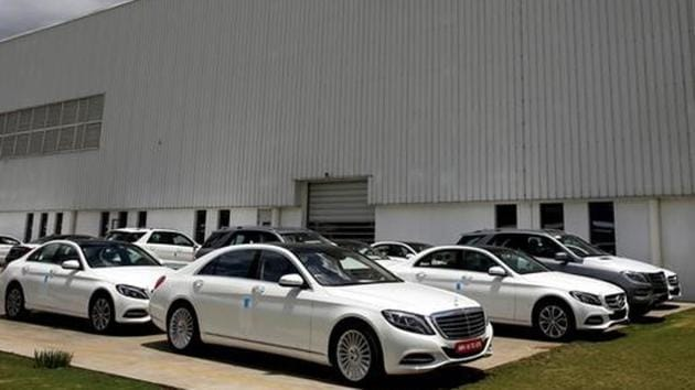 Different car models of Mercedes-Benz parked at the company's vehicle assembly plant in Chakan, outside Pune.