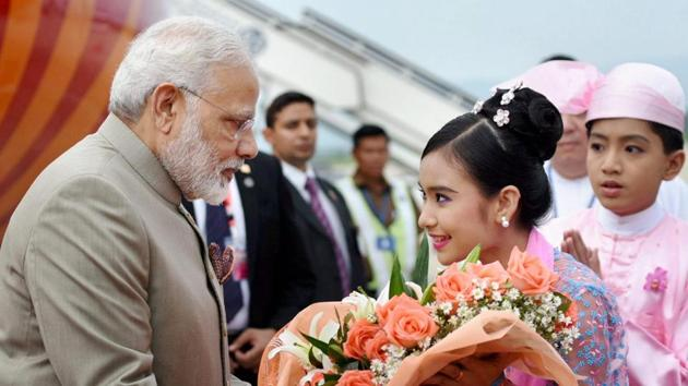Prime Minister Narendra Modi being welcomed on his arrival at Nay Pyi Taw International Airport, in Myanmar on Tuesday.(PTI Photo)