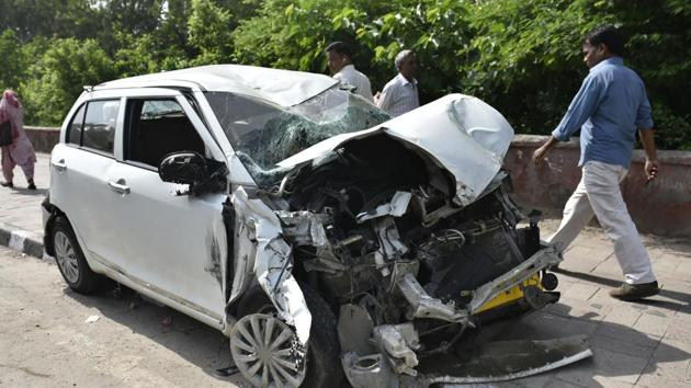 A mangled car at Safdar Jung and Ring Road crossing in New Delhi in July. Almost half or 46.3% of the road fatalities victim in 2016 were in the age-group of 18-35 years.(Sushil Kumar/HT File Photo)