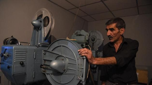 An employee preparing the screening of a film in a projection room at the state-run Afghan Film department in Kabul.(AFP)