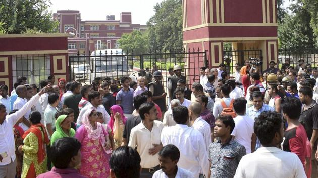 Demonstrators, including parents of students, protest on Saturday outside Gurgaon's Ryan International School as they demand action against the institute.(PTI)