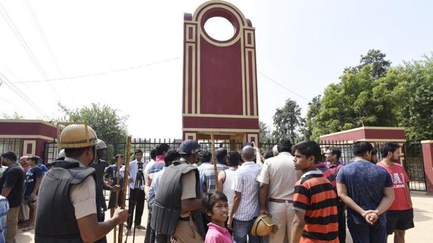 People gather outside the Ryan International School demanding action against the school, in Gurgaon.(Sanjeev Verma/HT Photo)