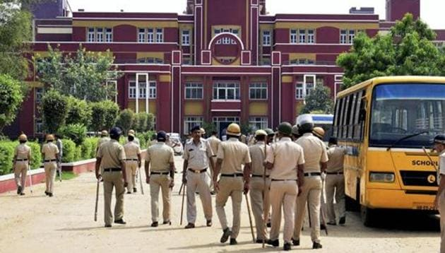 Police arrive to probe the murder at Ryan International School in Gurugram. The father of the murdered child has filed a plea in court seeking safety of children in schools.(PTI)