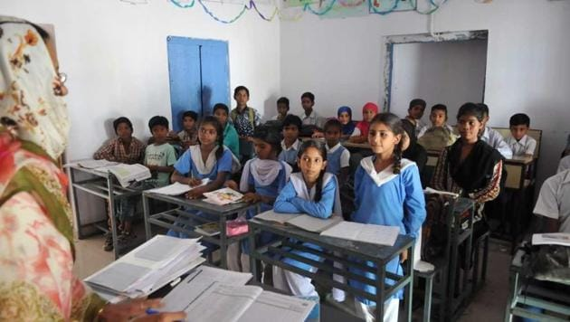 Students of the Government Ubedia High School in Bhopal attend classes.(Mujeeb Faruqui/ HT Photo)