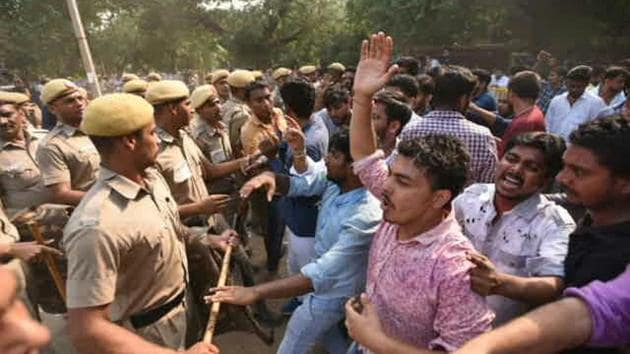 NSUI supporters clash with the police demanding recounting for votes for joint secretary seat.(Sushil Kumar / HT Photo)