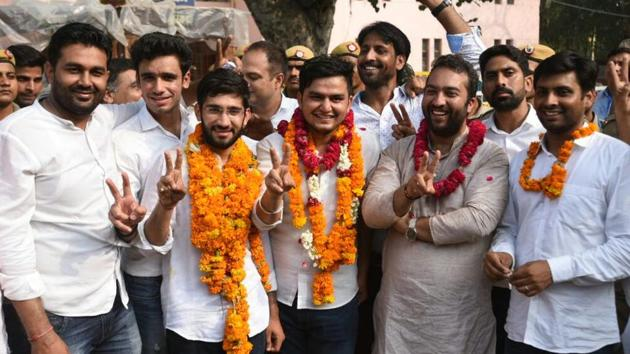 New DUSU president Rocky Tuseed (third from right) and vice-president Kumal Sehrawat (third from left) with NSUI supporters after the election results on Wednesday.(Sushil Kumar/HT Photo)
