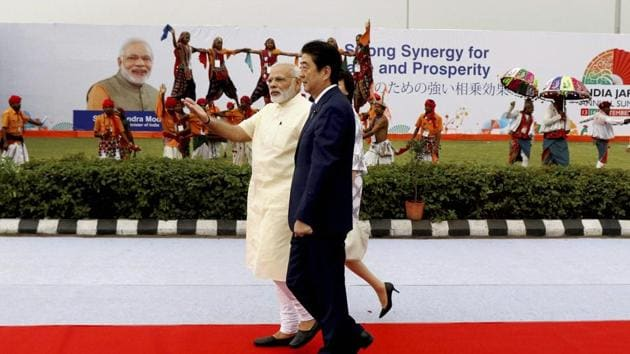Prime Minister of Japan Shinzo Abe walks with Prime Minister Narendra Modi at a welcome ceremony at Ahmedabad airport in Gujarat on Wednesday.(PTI)