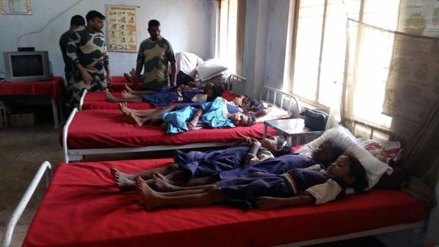School girls at the BSF's temporary hospital in Badapada on Friday where they were treated for food poisoning.(HT PHOTO)