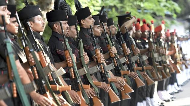 Defence personnel flank the procession for the state funeral of Marshal of the Indian Air Force Arjan Singh in New Delhi on Monday.(PTI Photo)