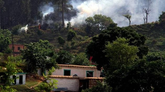 Smoke billows out after a mortar shell was allegedly fired by the Pakistani Army along the Line of Control in Rajouri district.(PTI file)