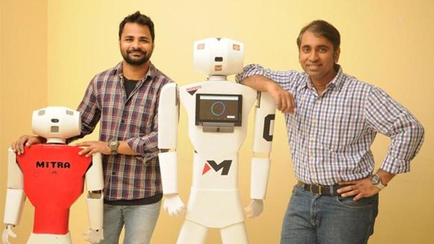 File photo of Balaji Viswanathan (right), one of the founders of Bengaluru-based Invento Robotics, and the Mitra robot.(Twitter)