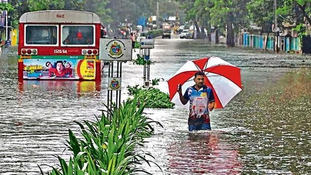 A man wades through a water-logged road during rains in Mumbai in August. Sudden heavy rainfall brought many cities like Mumbai, Chandigarh and Bengaluru to a halt. (REUTERS)