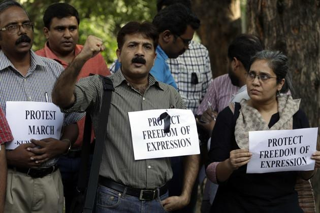 Journalists shout slogans during a protest in New Delhi against the killing of TV journalist Shantanu Bhowmick, who was abducted and killed while covering a protest rally in Tripura . According to the Committee to Protect Journalists, not a single journalist's murder in India had been solved over the past decade.(AP)