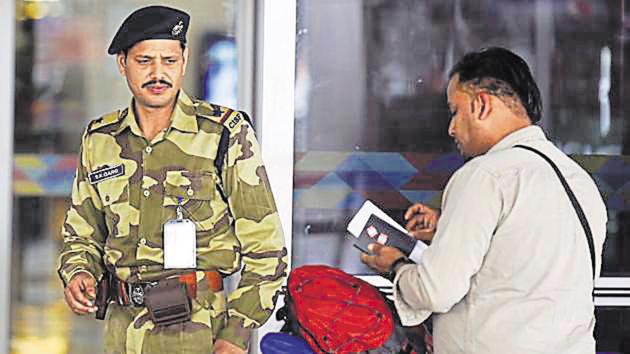 A CISF securityman during a security check at IGI Airport's T3 in New Delhi.(Ravi Choudhary/HT File Photo)