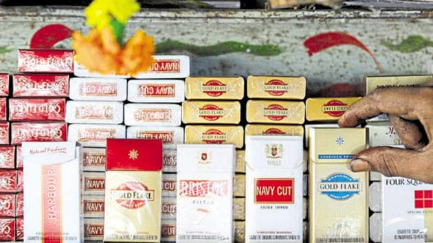 Cigarette packets are displayed at a shop in Mumbai.(AP File Photo)