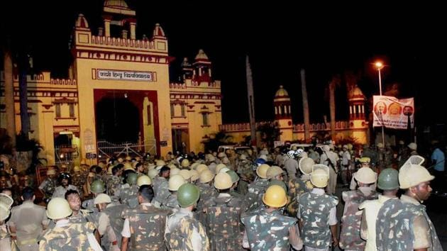 Securitymen at Banaras Hindu University on Saturday after students' protest against a case of sexual harassment . A probe report says the university administration did not handle the matter appropriately.(PTI)