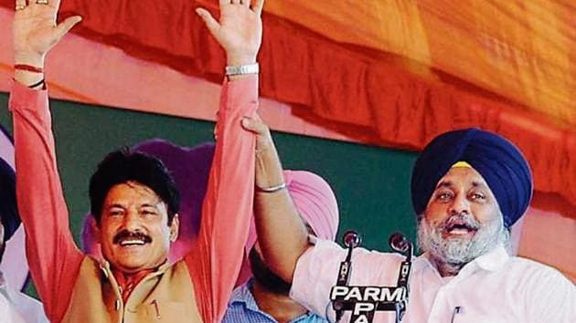 SAD chief Sukhbir Singh Badal at a rally to support SAD-BJP candidate Swarn Singh Salaria (left) for the byelections.(HT Photo)