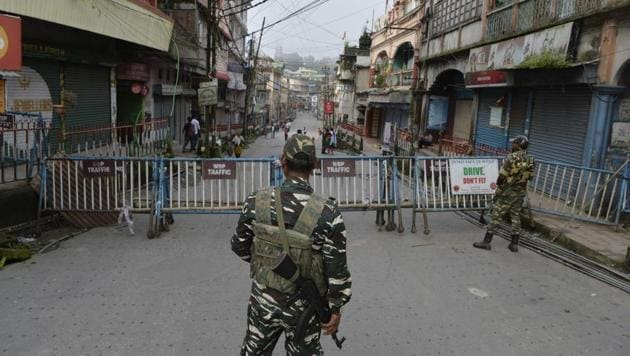 Paramilitary forces stand guard at the main market area during the indefinite strike called by the Gorkha Janmukti Morcha (GJM) for separate state Gorkhaland, in Kalimpong.(AFP File Photo)