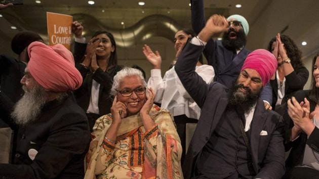 Jagmeet Singh (centre right) sits with his mother Harmeet Kaur, father Jagtaran Singh, and campaign manager Michal Hay as it's announced he has won the contest for leader of the leftist New Democratic Party in Toronto, Canada, on October 1, 2017. The former lawyer will have an uphill battle when he challenges Prime Minister Justin Trudeau's governing Liberal Party in the next election.(AP)