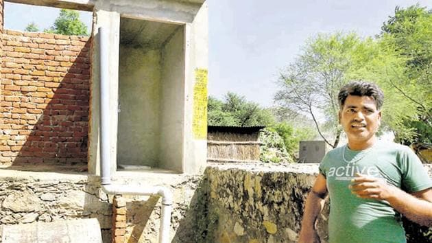 A man shows the incomplete toilet and bathroom at his house in a village in the outskirts of Jaipur.(Himanshu Vyas/HT Photo)