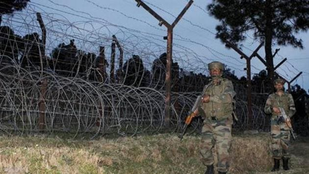 File Photo of Indian Army jawans patrolling at the Line of Control (LOC) in Poonch district of Jammu and Kashmir.(PTI Photo)