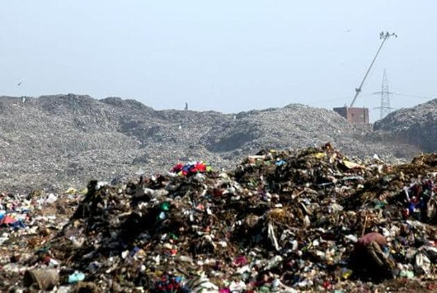 Earlier this year, the BMC issued a Letter of Intent to the contractor to start the process of land reclamation at the Mulund dumpyard, which is spread over 24 hectares.(HT PHOTO)