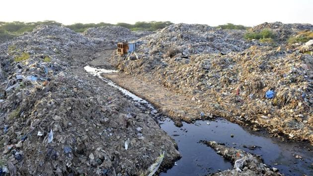 A report in August also stated that the compound wall was also found to have collapsed at various points of the dumping site.(HT FILE PHOTO)