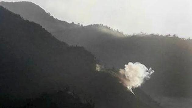 Smoke rises due to a mortar shell fired by Pakistani army near the line of control in Poonch sector on Monday.(PTI photo)