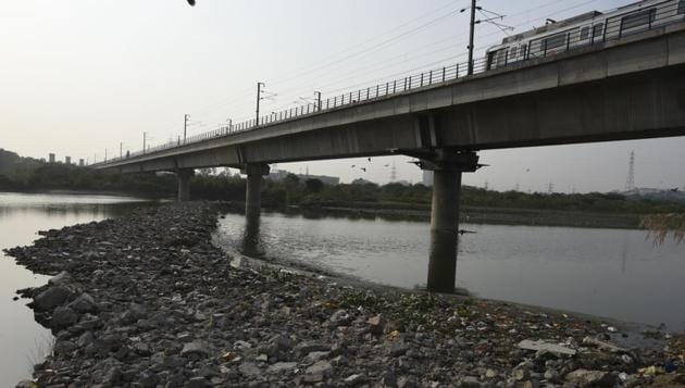 A temporary road that had come up on the river bed near Yamuna Bank Metro Station was demolished by DDA official a day after HT published the report on September 1. The road has now resurfaced.(Sushil Kumar / HT Photo)