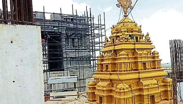 A sprawling 11-acre Yadadri temple complex that will consist of seven temple domes, including a 100-foot main dome, a 1,400 acre tourist facilities comprising cottages, multilevel parking, and housing for the temple priests.(HT Photo)
