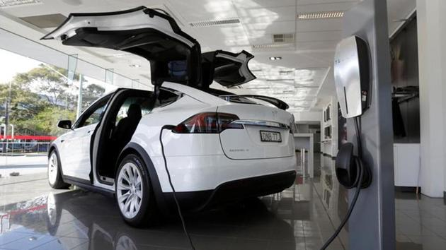 A Tesla wall connector demonstrates the charging at home of a Model X vehicle at a Tesla electric car dealership in Sydney, Australia.