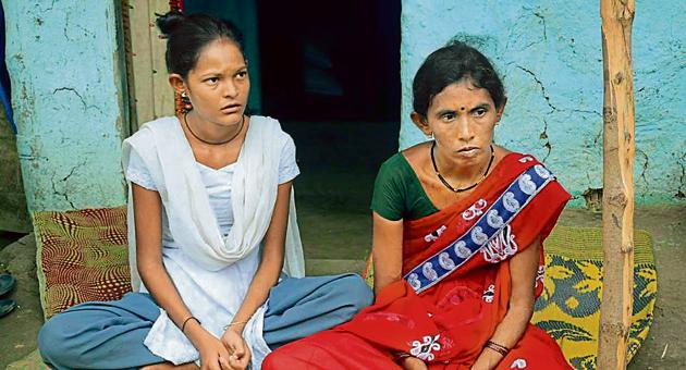 """Geeta Bandu Sonule and her daughter are distraught after her husband Bandu Sonule died on September 21. """"For how long will the compensation last? Will it bring back the light of our lives? Will lives continue to be lost? Will farmers meet the same end?"""" she asks.(Sanjib Ganguly/HT)"""